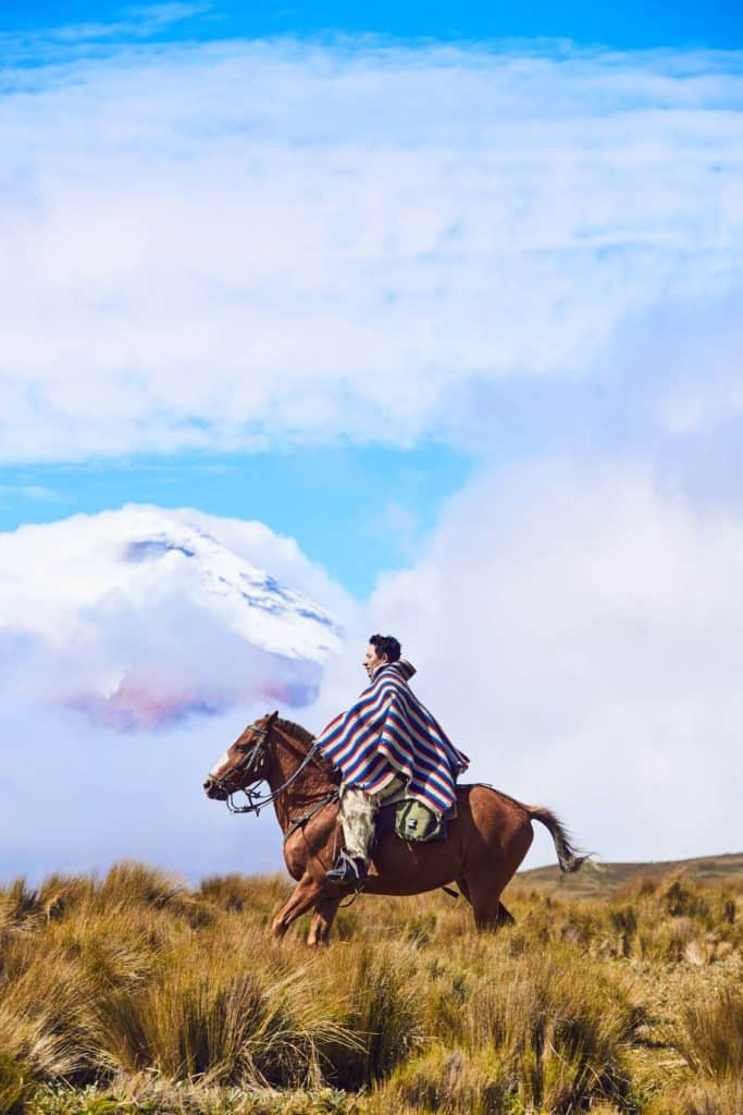 A chagra cowboy in the shadow of the volcano Cotopaxi at Tierra del Volcan