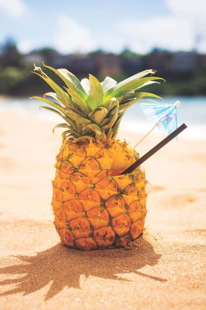 A pineapple cocktail on the beach