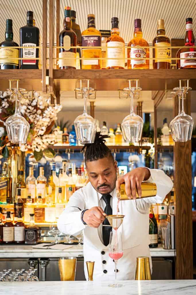 A bartender mixes a drink at The Pembroke