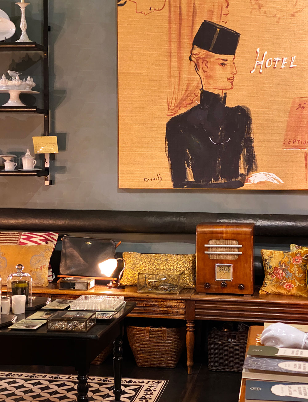 Antique pieces and a large painting inside a store.