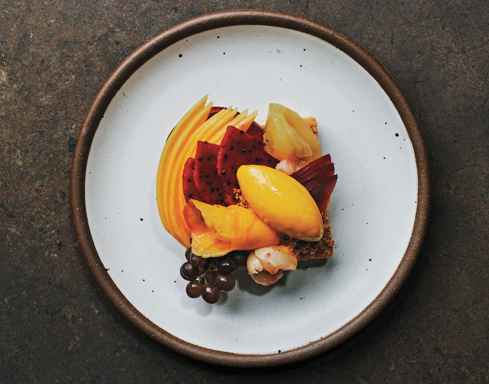 A colourful, fruity dessert on a white plate.