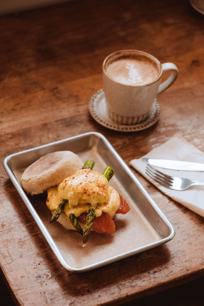 Eggs Benedict and a cup of coffee
