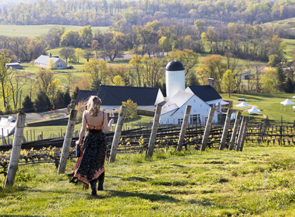 A young woman looking out onto the rolling hills of Virginia's countryside